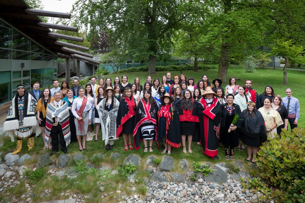 Aboriginal graduates gather at the UBC First Nations Longhouse for the First Nations House of Learning Graduation Celebration Photo Credit: Don Erhardt