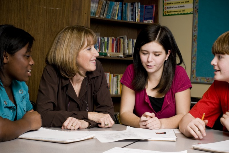 Students with Teachers by Intel Free Press - Flickr CC Attribution